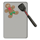 Gingerbread Boy  with spatula on cookie sheet