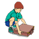 Boy in Green Shirt lifting briefcase