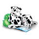 Two Dalmatians with green pillows and a book