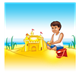 Boy Playing in Sand with a sand castle and a red bucket