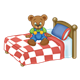 Button Bear sitting on a red and white bed