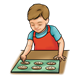 Boy Baking cookies on cookie sheet