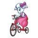 Amber Lamb riding a red tricycle in a pink dress