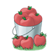 Bucket of Red Apples sitting on grass
