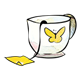 Teacup with yellow butterfly, tea bag hanging to side