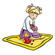Blond Girl sitting on blanket beside doll