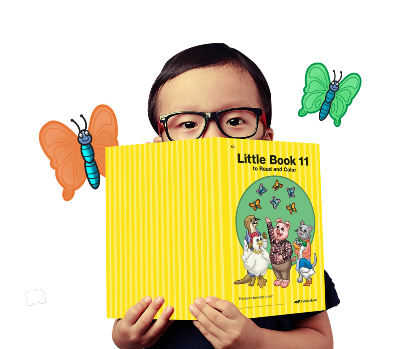 Little boy with book and butterflies